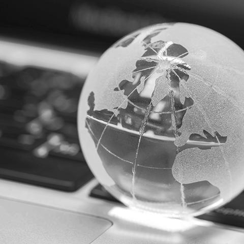 glass globe resting on a laptop